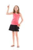 Menina de sorriso que aponta e que olha acima Imagem de Stock Royalty Free