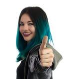 Menina de sorriso que mostra o polegar acima do sinal Fotos de Stock