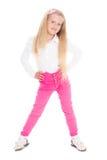 Menina de sorriso seis anos em calças de brim cor-de-rosa Foto de Stock Royalty Free