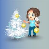 A menina decora a árvore de Natal Fotografia de Stock Royalty Free