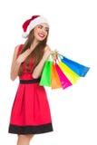 Menina deleitada do Natal com sacos de compras Imagens de Stock Royalty Free