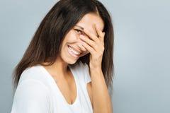 Menina deleitada positiva que cobre sua cara Fotografia de Stock Royalty Free