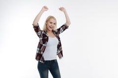Menina deleitada positiva que comemora sua vitória Imagem de Stock Royalty Free