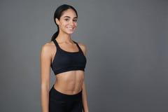 Menina deleitada positiva que sorri na câmera Fotos de Stock