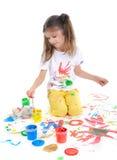 A menina desenha Imagens de Stock