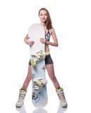Menina desportiva feliz do snowboarder no biquini com snowboard Isolado no fundo branco foto de stock