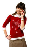 A menina diz por um telefone móvel Fotos de Stock