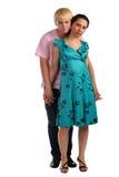 Menina do abraço do homem novo de atrás Imagens de Stock