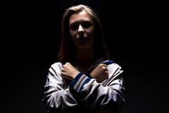 A menina do adolescente com braços cruzou-se em sua caixa Imagem de Stock Royalty Free