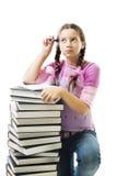 A menina do adolescente pensa sobre trabalhos de casa fotos de stock royalty free