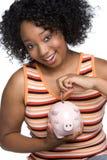 Menina do banco Piggy fotos de stock