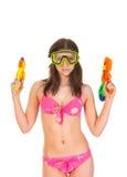 Menina do biquini com a arma de água dois Imagens de Stock Royalty Free