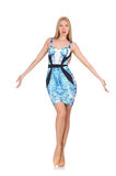 Menina do cabelo louro no mini vestido azul isolado sobre Foto de Stock Royalty Free