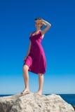 Menina do capitão no vestido roxo Imagem de Stock Royalty Free