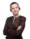 Menina do centro de atendimento que sorri e que olha acima no branco fotografia de stock