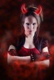 Menina do diabo com efeito de incêndio fotografia de stock royalty free
