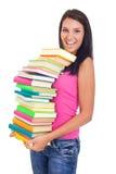 Menina do estudante com lote dos livros Fotografia de Stock Royalty Free