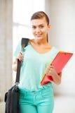 Menina do estudante com os dobradores do saco e da cor de escola Fotografia de Stock Royalty Free
