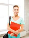 Menina do estudante com os dobradores do saco e da cor de escola Fotografia de Stock