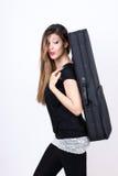 Menina do estudante com sua caixa do instrumento Imagem de Stock