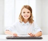 Menina do estudante com teclado Fotos de Stock