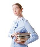 Menina do estudante com uma pilha dos livros Imagens de Stock