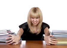 A menina do expressional move pilhas separadas dos papéis Fotos de Stock Royalty Free