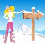 Menina do inverno com sinal de sentido. Fotografia de Stock
