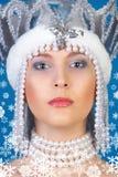 Menina do inverno sobre o azul Imagem de Stock Royalty Free