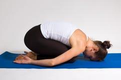 Menina do iogue Foto de Stock