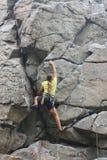 Menina do montanhista na rocha Foto de Stock Royalty Free