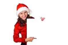 Menina do Natal com sinal em branco Fotos de Stock Royalty Free