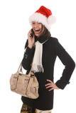 Menina do Natal com telefone de pilha imagens de stock royalty free
