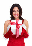 Menina do Natal do ajudante de Santa com um presente. Fotografia de Stock Royalty Free