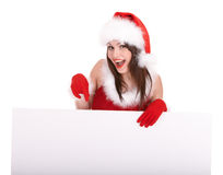 Menina do Natal no chapéu de Santa com bandeira. fotografia de stock