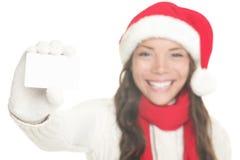 Menina do Natal que mostra o sinal do cartão Foto de Stock Royalty Free