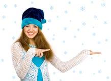 Menina do Natal sobre a parte traseira do branco Foto de Stock