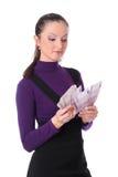 A menina do negócio está contando o dinheiro foto de stock
