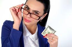 Menina do negócio que guarda o dinheiro Fotos de Stock Royalty Free