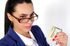 Menina do negócio que guarda o dinheiro Imagem de Stock