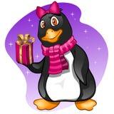 Menina do pinguim com presente Fotografia de Stock