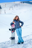 Menina do Snowboarder Fotos de Stock Royalty Free