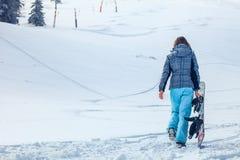Menina do Snowboarder Fotos de Stock