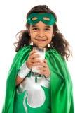 Menina do super-herói com vidro do leite foto de stock