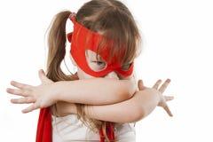 Menina do super-herói em um vermelho Imagens de Stock