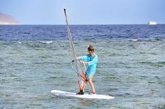 Menina do surfista do vento Imagem de Stock Royalty Free