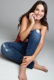 Menina do telefone de pilha Fotos de Stock