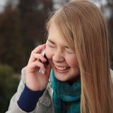 Menina do telefone de pilha Fotos de Stock Royalty Free