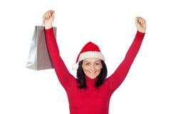 A menina do vencedor com chapéu do Natal vai comprar Imagens de Stock