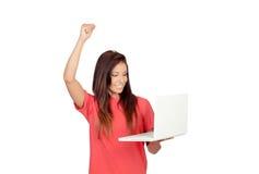 Menina do vencedor com um portátil Fotos de Stock Royalty Free